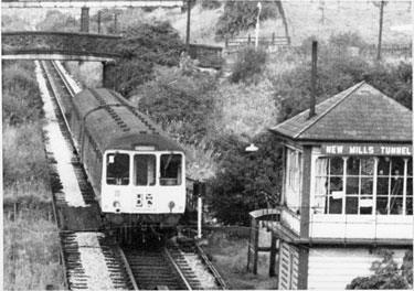 Hayfield railway line, New Mills, with diesel train. Signal Box - New Mills Tunnel End - and St George's Road bridge. View towards Hayfield.